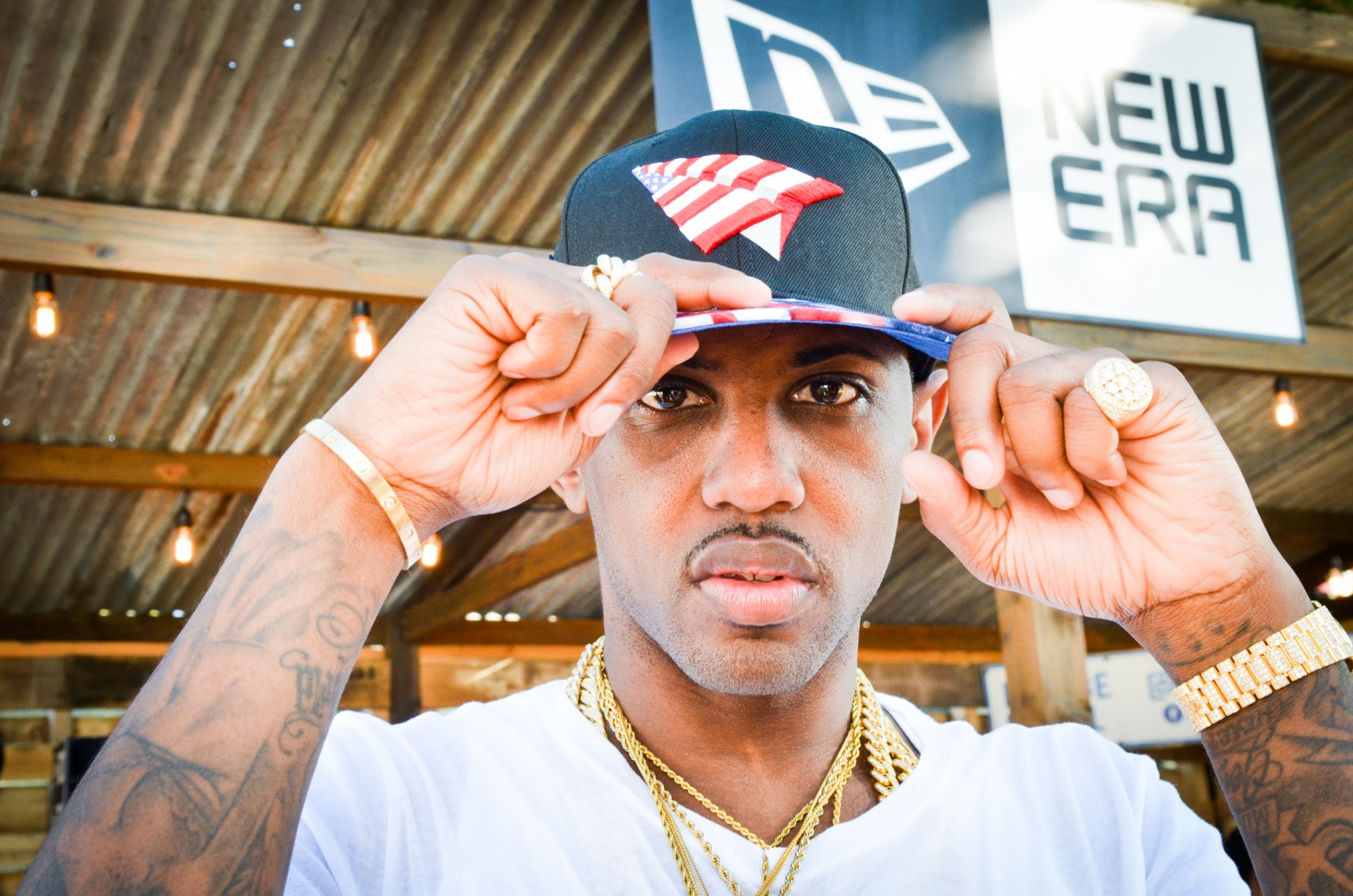 979b95300c7f Hip hop artist Fabolous picks out a hat New Era booth on the second day of
