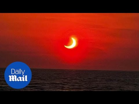 'Ring of fire' solar eclipse paints New York sky red