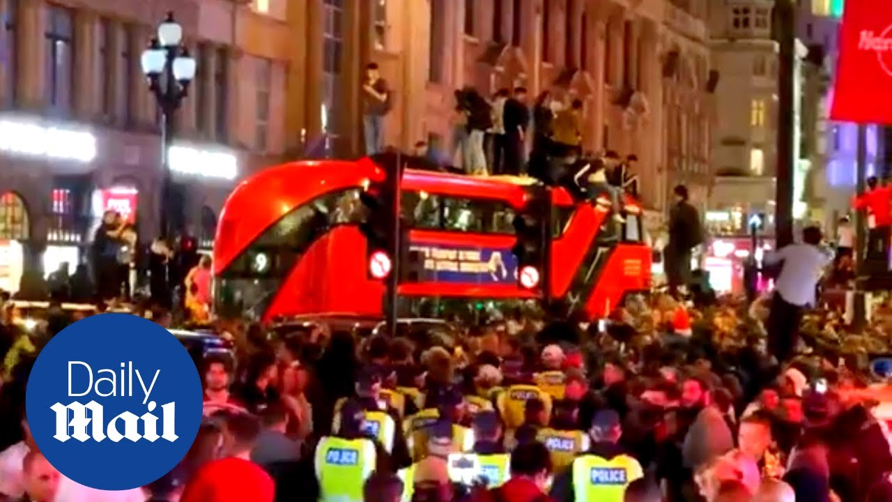 Ecstatic England fans jump on roof of London bus after Denmark Euro 2020 win